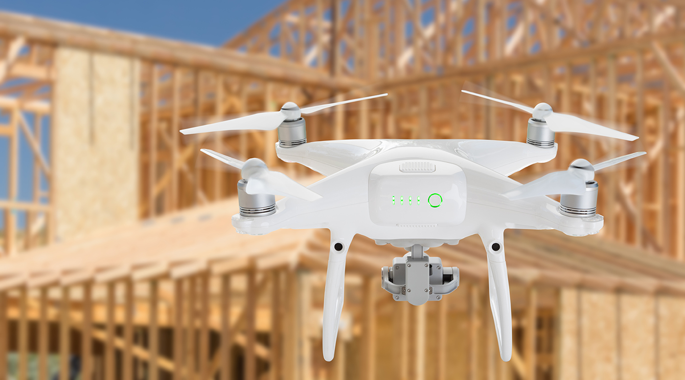 Aerial drone being flown by one of our home inspectors over a new house construction site