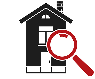 Home Inspector looking at house