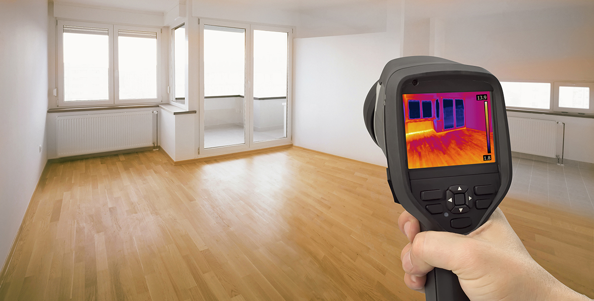 Thermal imaging device being used by our home inspectors to detect heat leaking thru windows